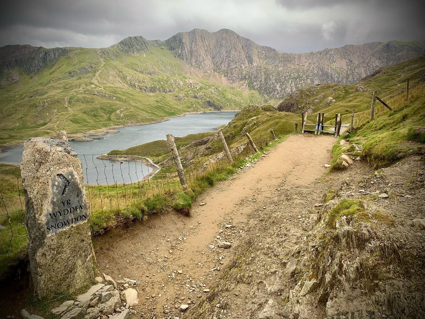 Adventures this way! We love this moody shot from a guided walk up Snowdon this summer, views that never get old! ⛰🥾⛰ . . . #wildernessdevelopment #snowdon #snowdonia #snowdonianationalpark #pygtrack #penypass #guidedwalk #hikebritain #lovemyoffice #outdooroffice  #hikingadventures #ukhikingofficial #hiking #hikersuk #mapmyhike #outdoorhikingculture #mountainsfellsandhikes #outdoorpursuits #outdooradventures #outdooractivities
